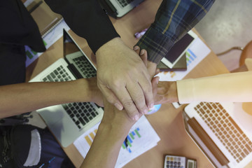 Business people join hand together during their meeting teamwork concepts