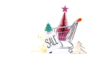 Image of cart with Christmas tree, greeting card, ribbon on empty white background.