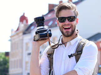 Tourist takes picture of cityscape. Young traveller or photographer