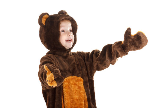 Child in a christmas carnival bear costume isolated on white