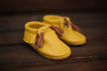 Cute little yellow child shoes with brown lace