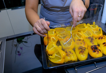 Woman hands cooking yellow pepper