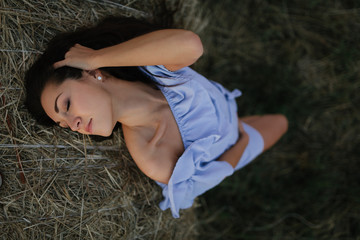 young healthy sensual woman on the sunrise field