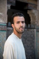 Arab man wearing traditional long white shirt