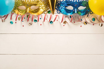 Colorful carnival on white wood background