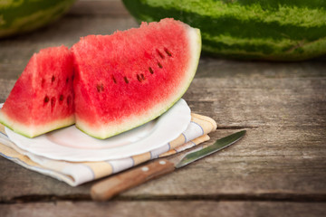 Watermelon on plate with knife