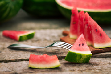 Watermelon slice and fork