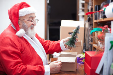Santa Clause packing a gift
