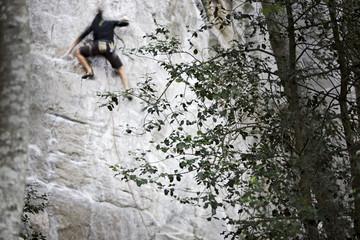 Man climbing at rock face, Schilthorn, Bernese Oberland, Canton of Bern, Switzerland