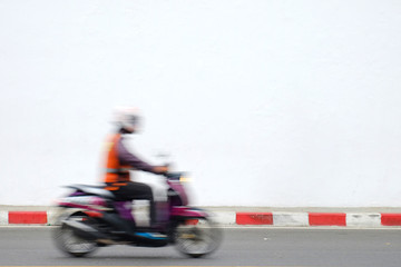 Motion blur bike rider on the street