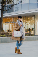 Woman walking with shopping bags