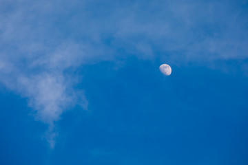 Half moon on blue sky and cloud