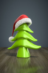 a red christmas hat on a green tree