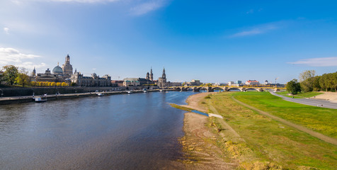 Scenic autumn view of Elbe river, Augustus Bridge and Old Town, Dresden, Saxony, Germany, Europe