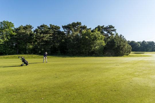 Mature man playing golf at a golf course