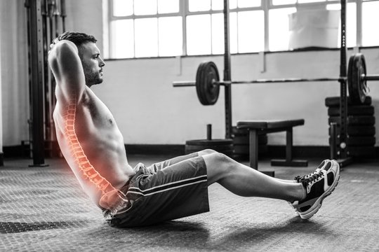 Highlighted spine of exercising man at gym