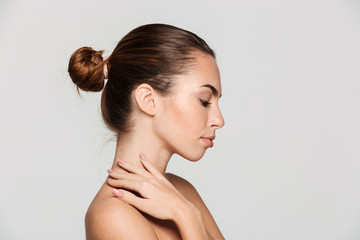 Side view beauty portrait of a beautiful half naked woman