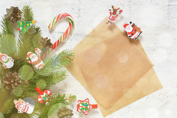 Postcard with decorative clothespins on a white background. New Year background with space for text. Merry Christmas and Happy New Year!