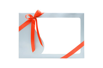 Gift Box with ribbon bow tied with blank frame for product display, isolated on white background with clipping path.