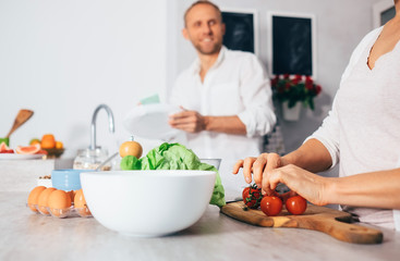 Couple on kitchen cooks together 2