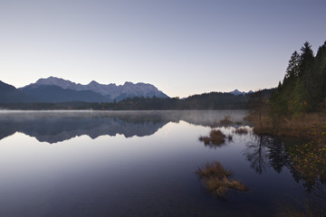 Morning mist, view over lake Barmsee to the Karwendel mountains, near Mittenwald, Bavaria, Germany