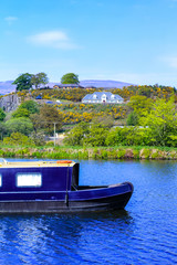 Forth and Clyde Canal with long boats in Scotland, UK