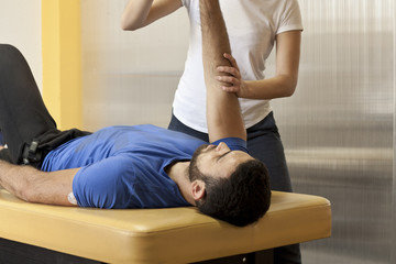 Physiotherapist working with patient
