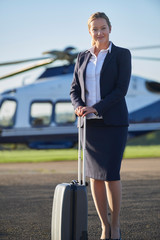 Portrait Of Businesswoman Standing In Front Of Helicopter