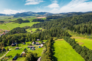 Slovakian town Stara Lubovna on forested hillside. beautiful rural scenery in mountainous area viewed from above on a summer day.