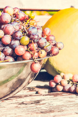 A big bowl of grapes picked up in the garden.