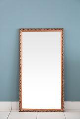 Beautiful big mirror near color wall