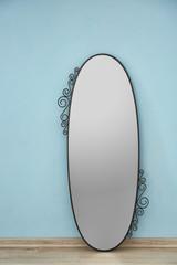 Beautiful big mirror near light wall
