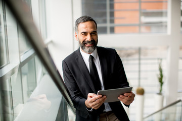 Businessman with tablet in the office