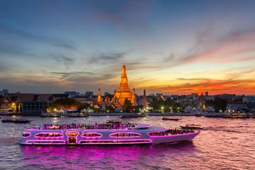 Wat Arun and cruise ship in twilight time, Bangkok city, Thailand