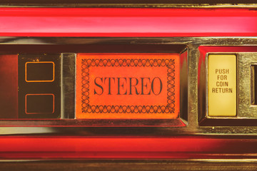 Close up of a vintage jukebox with the text stereo