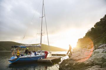 Sailboat moored at rocky coast at sunset, Istria, Croatia