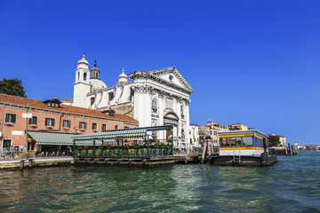 "View of the church of Gesuati or Santa Maria del Rosario from the Grand Canal, the cafe and the vaporetto stop ""Zattere"". Venice. Italy."