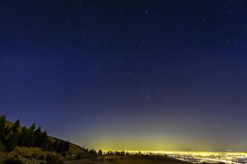 Winter starry night sky. Color image