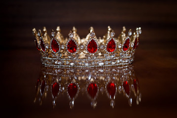 Royal crown red stones. Wealth symbol of power and success