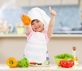 Chef girl preparing healthy food in kitchen