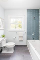 Modern bathroom with soft blue Mosaic glass tiles.