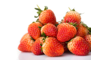 Fresh strawberries on white background. With copy space.