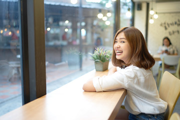 Portrait of beautiful asian girl smiling at cafe, Relaxing time
