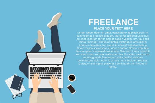 Freelancer working at home with laptop, top view. Concept of remote working or working at home. Outsourced employee, developer or web designer