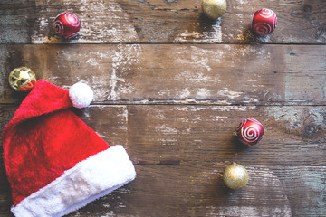 Christmas holiday background with old wood and Santa hat