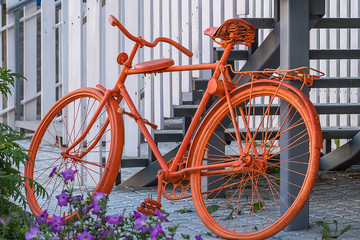 flowers and painted in orange color bike