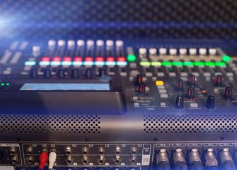 Professional audio mixing console in studio.