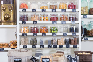 Image of showcase with dried fruits in containers