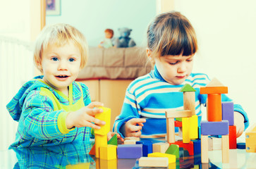 happy children playing with  toys in home