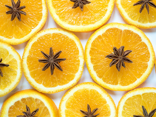 Abstract background with citrus fruit of orange slices and star anise.